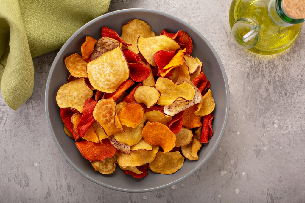 Healthy vegetable baked chips made from beets, sweet potato and parsnip